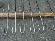 Picture of Anchor Rods Being Coated with Bituminous
